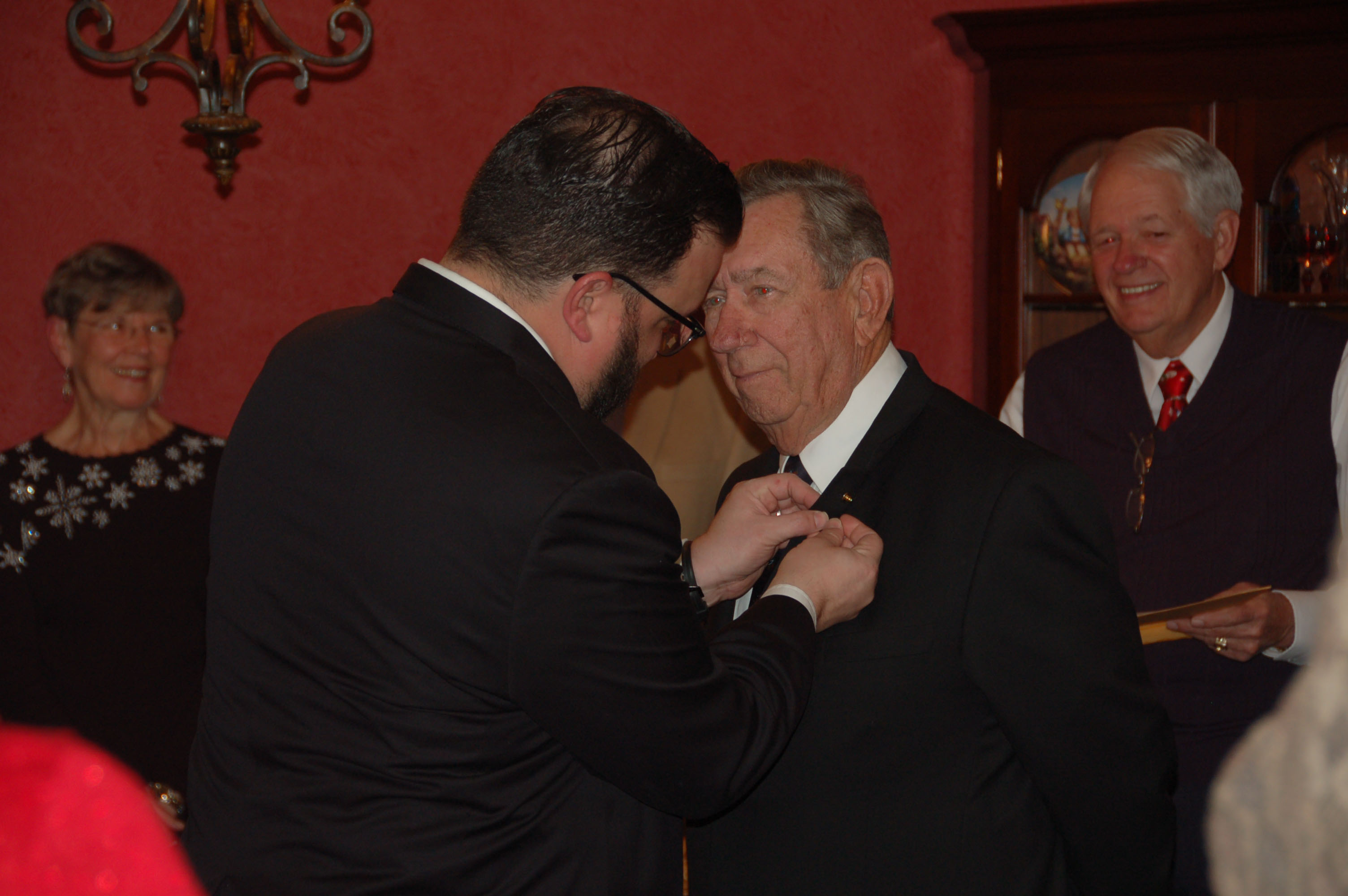 Ken Knotts pinning the Golden Trowel Lapel Pin on Harry Wood